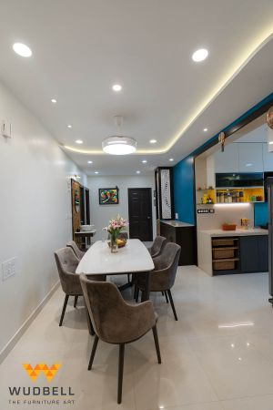 A neat and clean look of the dining area and living room