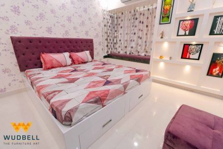 Comfy bed with cushioned headboard
