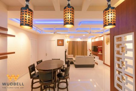 Intimate and modest dining space with hanging lights