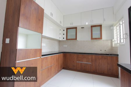 Ivory-white tiles with black countertop