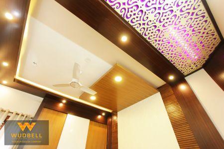 Master bedroom veneer finish false ceiling and CNC grid false ceiling.