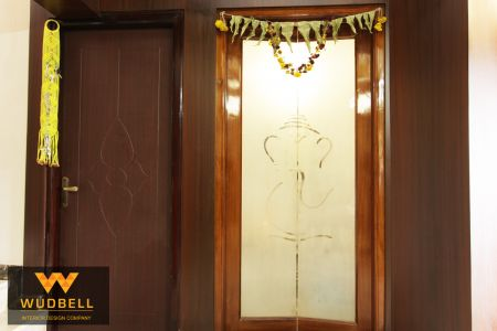 Pooja unit with veneer finish and Ganesh god design frosted glass door.
